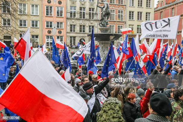 Protesters with European Union and Polish flags and antigovernment slogans are seen on 11 March 2017 in Gdansk Poland People take part in the protest...