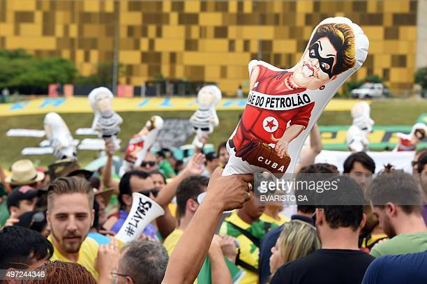 Protesters with inflatable dolls of Brazilian President Dilma Rousseff and former president Lula da Silva demonstrate calling for her impeachment and...