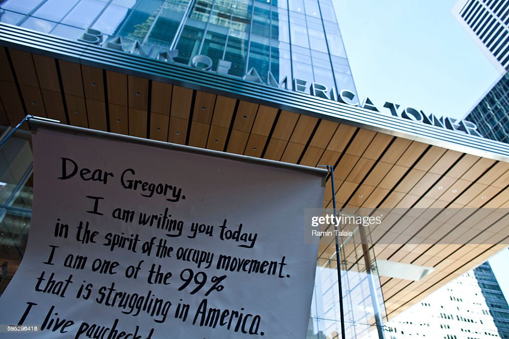 Protesters with Occupy Wall Street movement open a banner in front of the Bank of America Tower in New York City on Friday October 28 2011 Hundreds...