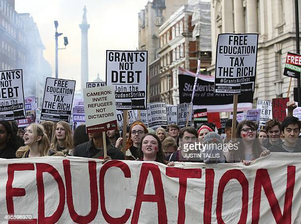 Protesters with placards and banners chant slogans outside Downing Street during the annual demonstration against student fees in central London on...