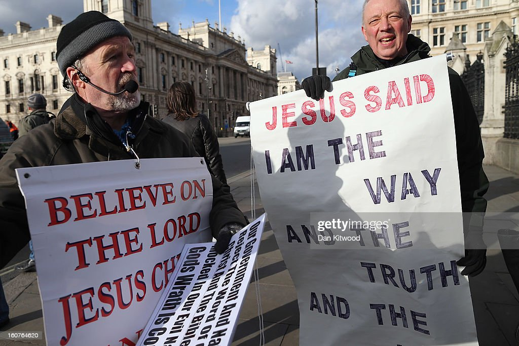 Protesters with religious placards stand in front of Parliament on February 5, 2013 in London, England. Later Parliament will hold a vote on whether to allow homosexual couples to marry.