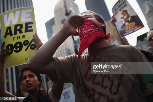 Protesters with the 'Occupy Wall Street' movement chant before walking up 5th Avenue to demonstrate in front of the residence of NewsCorp CEO Rupert...