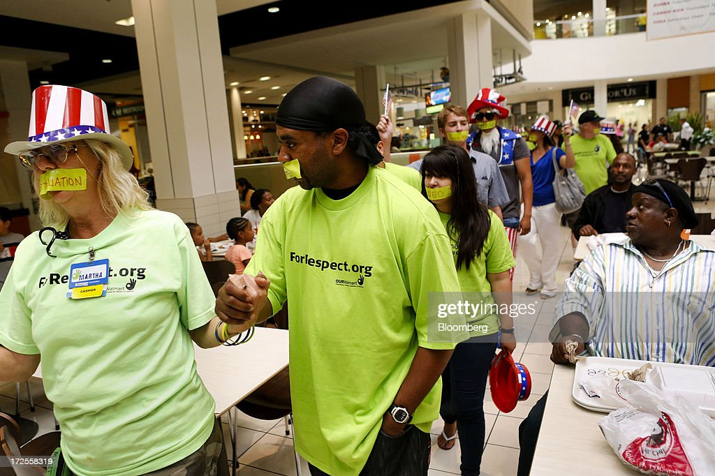 Protesters with the Organization United for Respect at Walmart (OUR Walmart) demonstrate outside a Wal-Mart Stores Inc. location in Los Angeles, California, U.S., on Tuesday, July 2, 2013. Southern California community supporters joined Wal-Mart Stores Inc. workers to protest against alleged illegal violations of employees labor rights and freedom of speech. Photographer: Patrick T. Fallon/Bloomberg via Getty Images