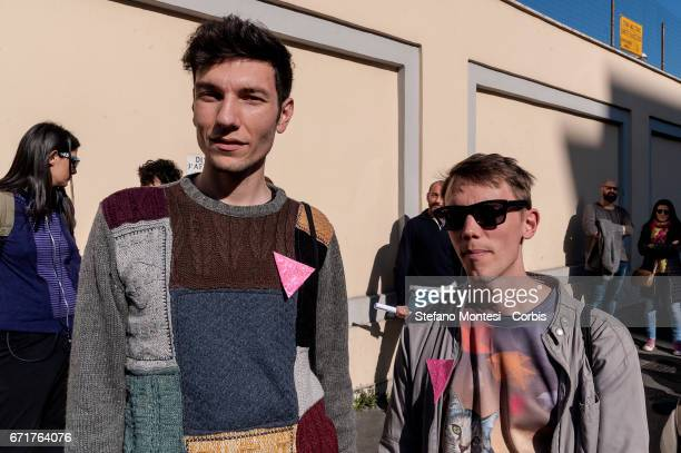 Protesters with the pink triangle on jackets symbol of the extermination of homosexuals during Nazifascism during the demonstration of LGBT...