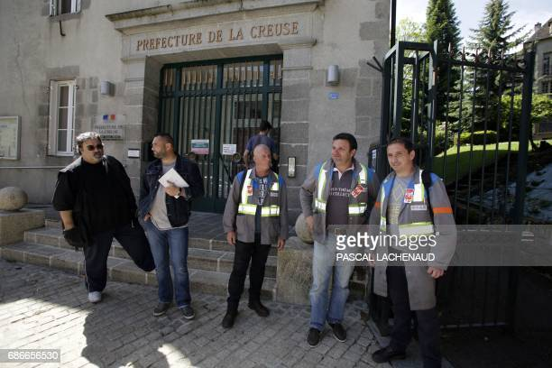 Protesting employees of GMS car supplier under threat of closure including CGT unionists Vincent Labrousse and Patrick Brun arrive to meet with...