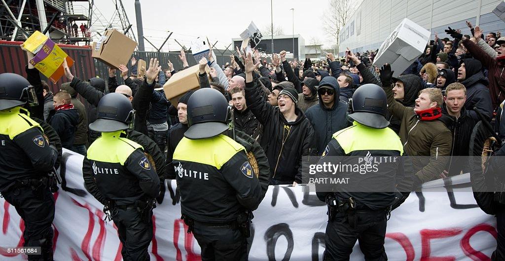 Protesting fans of football club Feyenoord Rotterdam face ...