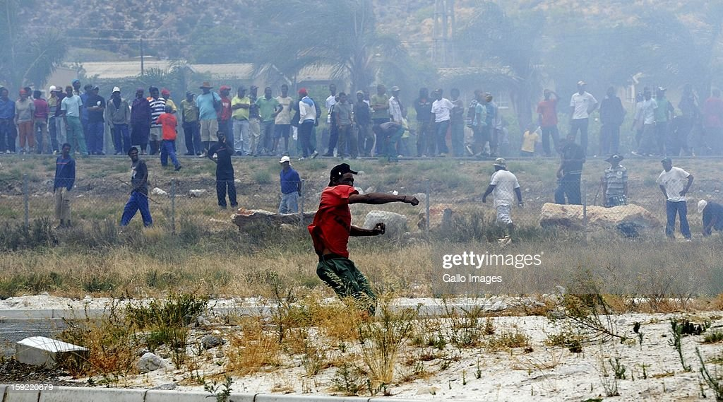 Protesting farm workers at the N1 De Doorns protest on January 9, 2013, in Cape Town, South Africa. The protest turned violent as farm workers shut down the N1 by lighting tires on fire and placing large rocks on the road.