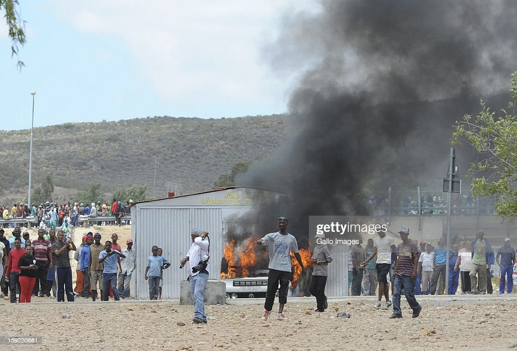 Protesting farm workers on January 9, 2013, in Cape Town, South Africa. The farm workers shut down the N1 by lighting tires on fire and placing large rocks on the road.