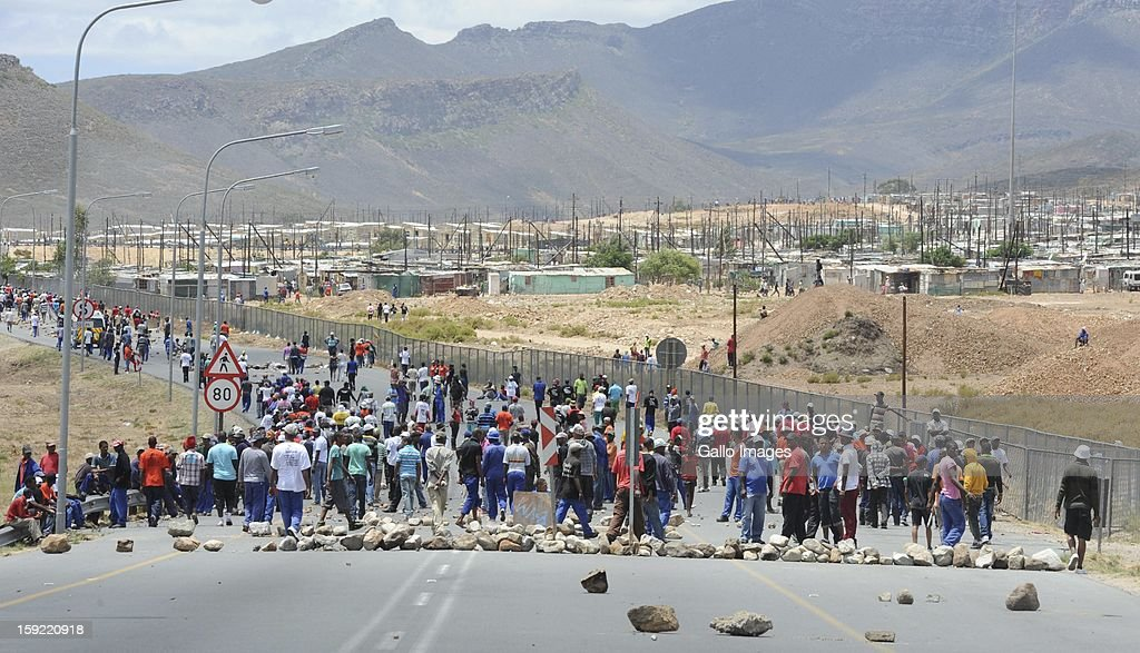 Protesting farm workers on the N1 highway at De Doorns on January 9, 2013, in Cape Town, South Africa. The farm workers shut down the N1 by lighting tires on fire and placing large rocks on the road.