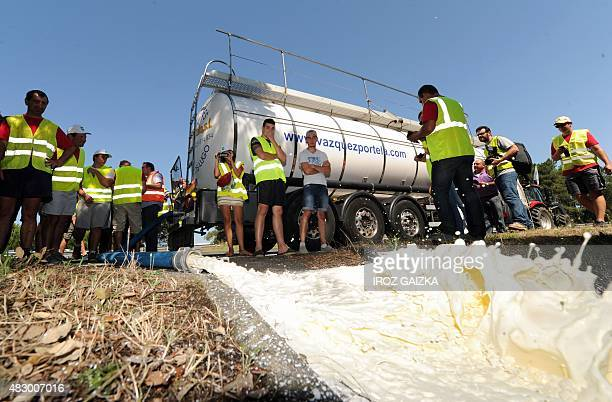 Protesting farmers called by the FNSEA empty milk from a refrigerated tanker coming from Spain on the parking lot of the A63 highway tollgate in...