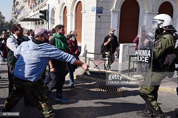 Protesting farmers clash with riot police officers during a rally in front of the Greek parliament on November 18 2015 in Athens Thousands of farmers...
