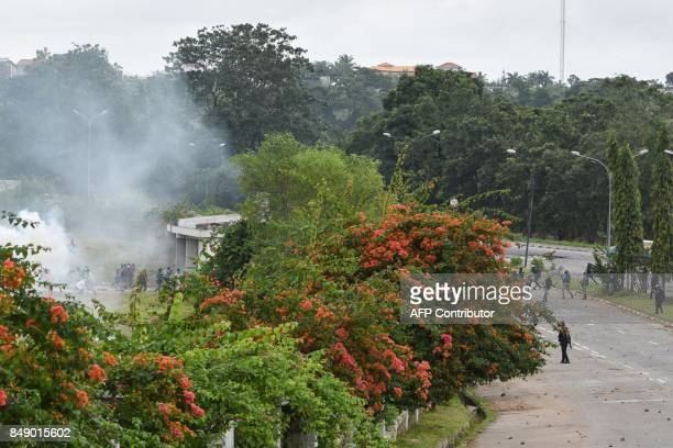 Protesting students clash with Ivorian police officers within a demonstration against rising education costs at the Felix Houphouet Boigny University...