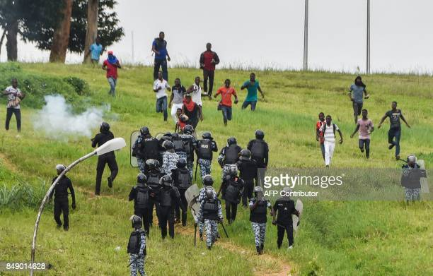 Protesting students holding stones clash with Ivorian police officers within a demonstration against rising education costs at the Felix Houphouet...