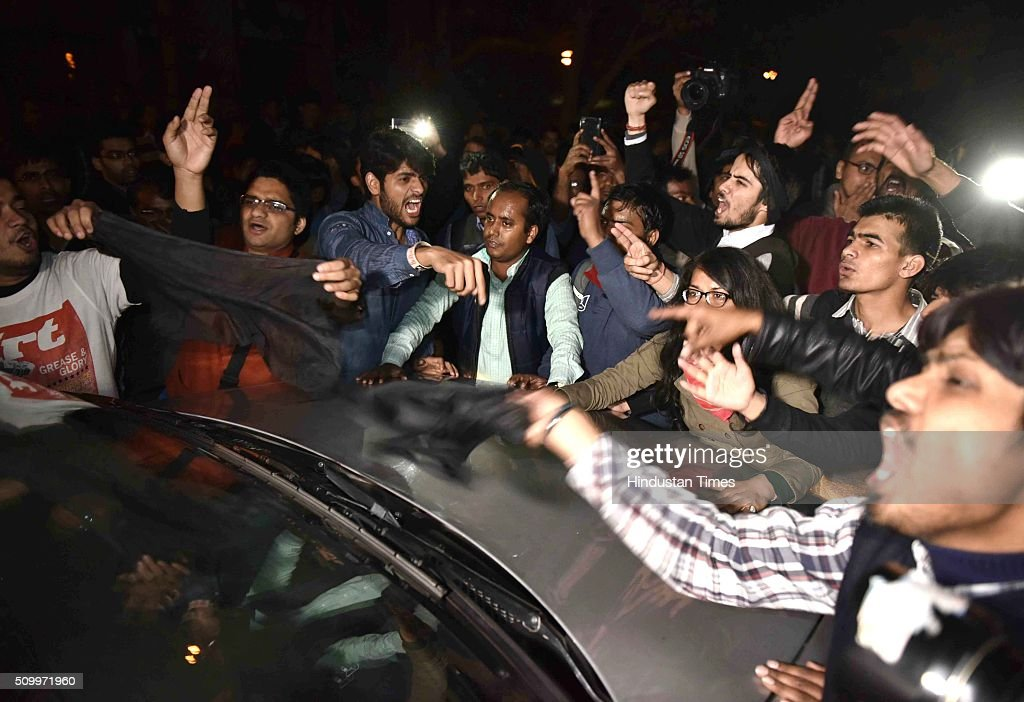 Protesting students show black flag to Congress Vice President Rahul Gandhi who joined the students protesting over the release of JNU Student's Union president Kanhaiya Kumar at Jawaharlal Nehru University, on February 13, 2016 in New Delhi, India. Congress Vice President Rahul Gandhi slammed the Centre and said it is terrified of people who are raising their voices. He said, the most anti-national people are the people who are suppressing the voice of this institution. JNU Student's Union president Kanhaiya Kumar was arrested in connection with a case of sedition, seven more students from the university have been detained after a controversial event to protest the hanging of 2001 Parliament attack convict Afzal Guru three years ago. The protesters also allegedly shouted anti-India slogans during the event.