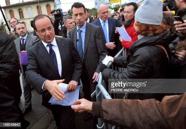 Protesting workers from local companies which risk having to close down give fliers to French President Francois Hollande in Latresne southwestern...