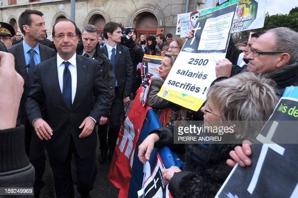 Protesting workers from local companies which risk having to close down show posters to French President Francois Hollande in Latresne southwestern...