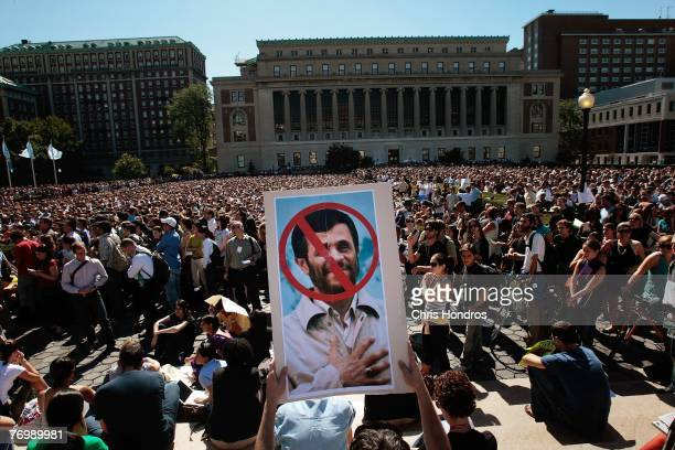 A protestor at Columbia University hold s up a sign during a protest of a speech by Iranian President Mahmoud Ahmadinejad on the campus of Columbia...