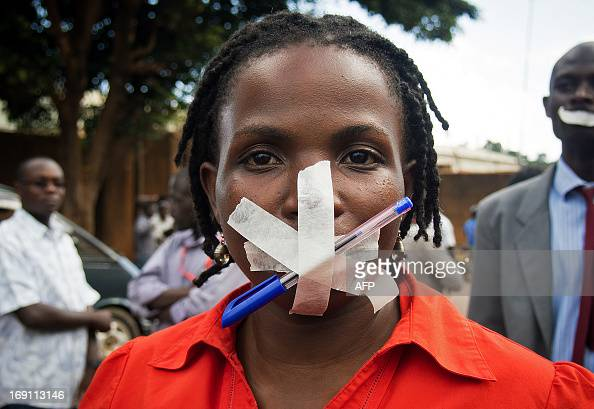 A protestor at the Daily Monitor newspaper poses in Kampala on May 20 2013 Ugandan police raided The Red Pepper newspaper the Daily Monitor newspaper...