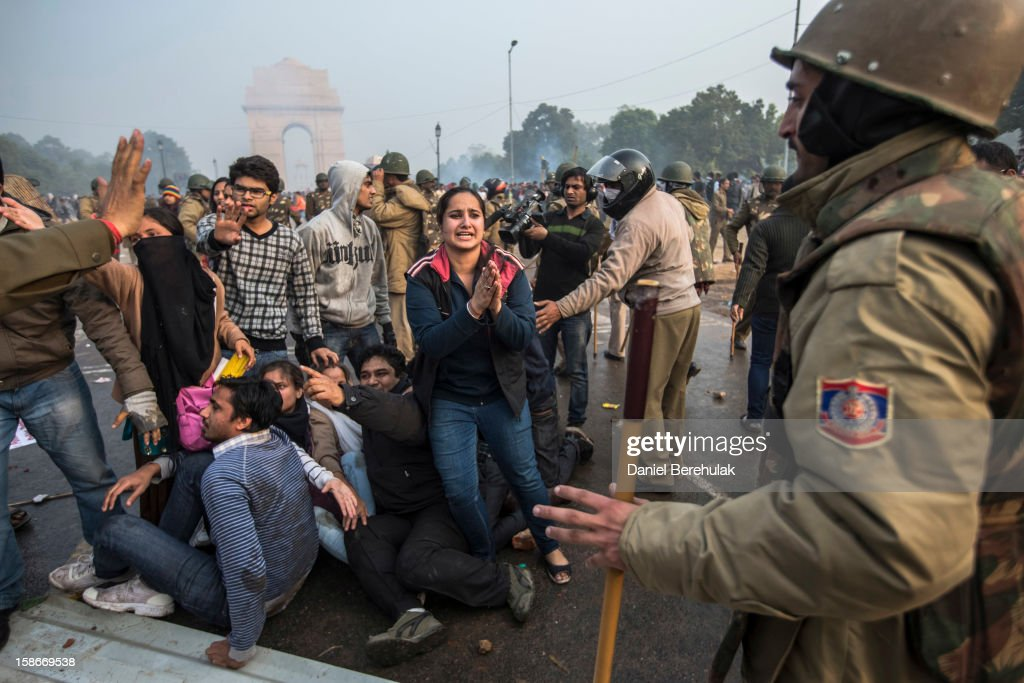 A protestor begs for mercy as Delhi police lathi charge during a protest against the Indian governments reaction to recent rape incidents in India, in front of India Gate on December 23, 2012 in New Delhi, India. The gang rape of a 23-year-old paramedical student in a moving bus on December 16, in Delhi, has led to people to react openly against the governments current rape laws. Over a thousand protesters gathered in front of Delhi to protest against lax laws and the governments handling of recent rape cases all over India.