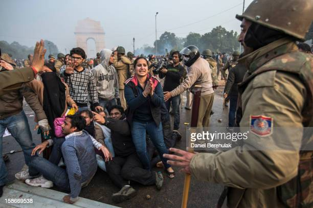 A protestor begs for mercy as Delhi police lathi charge during a protest against the Indian governments reaction to recent rape incidents in India in...