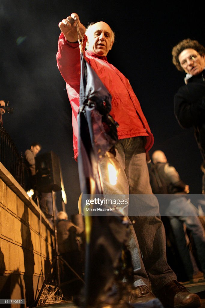 A protestor burns an EU flag during a protest against austery measures and the Troika on March 27, 2013 in Nicosia, Cyprus. After days of negotiation, Eurozone finance ministers have agreed terms for a 10 billion euro bailout deal, which aims to prevent the collapse of Cypriot banks and ensure that Cyprus remain in the Eurozone. Yiannis Kyrpi, the chief executive of Bank of Cyprus, has been removed from his post following the agreement, whilst banks remain closed to the public and are expected to enforce withdrawal restrictions when they re-open.