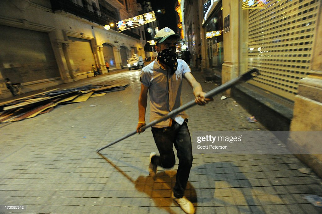 A protestor carries a metal bar while building a barricade against Turkish police along the Istikhlal shopping avenue near Taksim Square on July 6, 2013 in the heart of Istanbul, Turkey. The protests began in late May over the Gezi Park redevelopment project and saving the park trees adjacent to Taksim Square but swiftly turned into a protest aimed at Prime Minister Recep Tayyip Erdogan and what protestors call his increasingly authoritarian rule. The protest spread to dozens of cities in Turkey, in secular anger against Erdogan and his Islam-rooted Justice and Development Party (AKP).