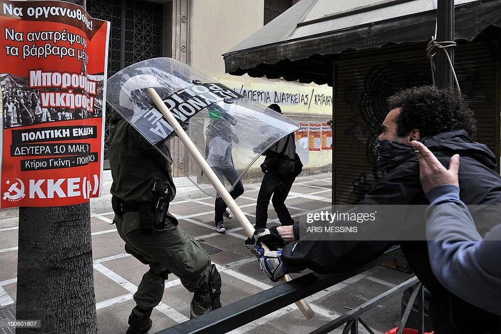 A protestor clashes with police in the center of Athens on May 5, 2010. Athens police chiefs mobilized all their forces, including those not on active duty, to restore order on May 5 amid rioting during protests against a government austerity drive. Police were put on a 'general state of alert' to deal with the clashes after three people died in a bank that was firebombed on the margins of the demonstrations.