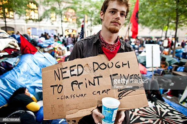 A protestor collects money at Zuccotti Park during a demonstration in New York City on Saturday October 8 2011 Hundreds of protestors have camped out...