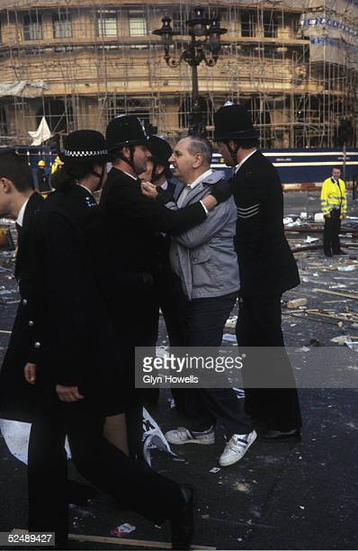 A protestor confronts police at the the scene of the Poll Tax demonstration and subsequent riot in Trafalgar Square London 31st March 1990