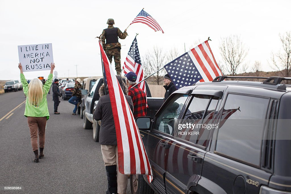 Protestor Dala Bechtel and others show their support at the Malheur Wildlife Refuge Headquarters near Burns, Oregon on February 11, 2016. The FBI surrounded the last protesters holed up at a federal wildlife refuge in Oregon amid reports they will surrender on Thursday, suggesting the weeks-long armed siege is approaching a climax. / AFP / Rob Kerr