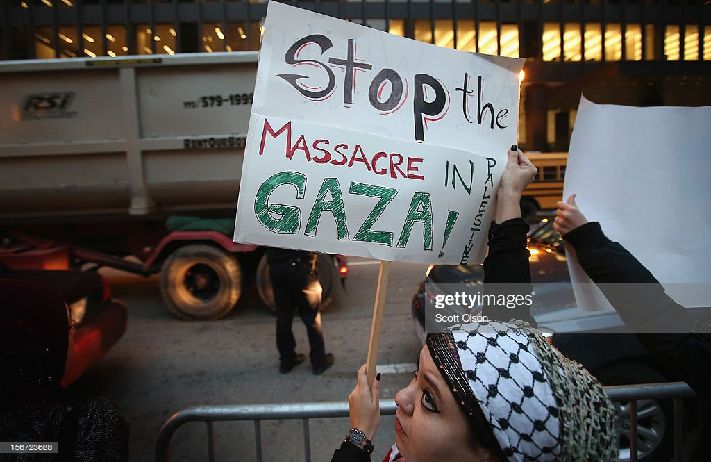 A protestor demonstrates against Israeli attacks on Gaza on November 19, 2012 in Chicago, Illinois. Several hundred people joined the protest which started with a rally in the Federal Building Plaza and finished with a march through the Loop during rush hour.