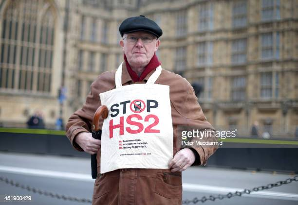 A protestor demonstrates against the High Speed 2 rail line at Parliament on November 25 2013 in London England Legislation for the proposed HS2 line...