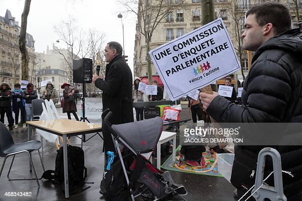 A protestor displays a placard calling for a Parliamentary commision to investigate the needs of people with Autism during a demonstration to raise...