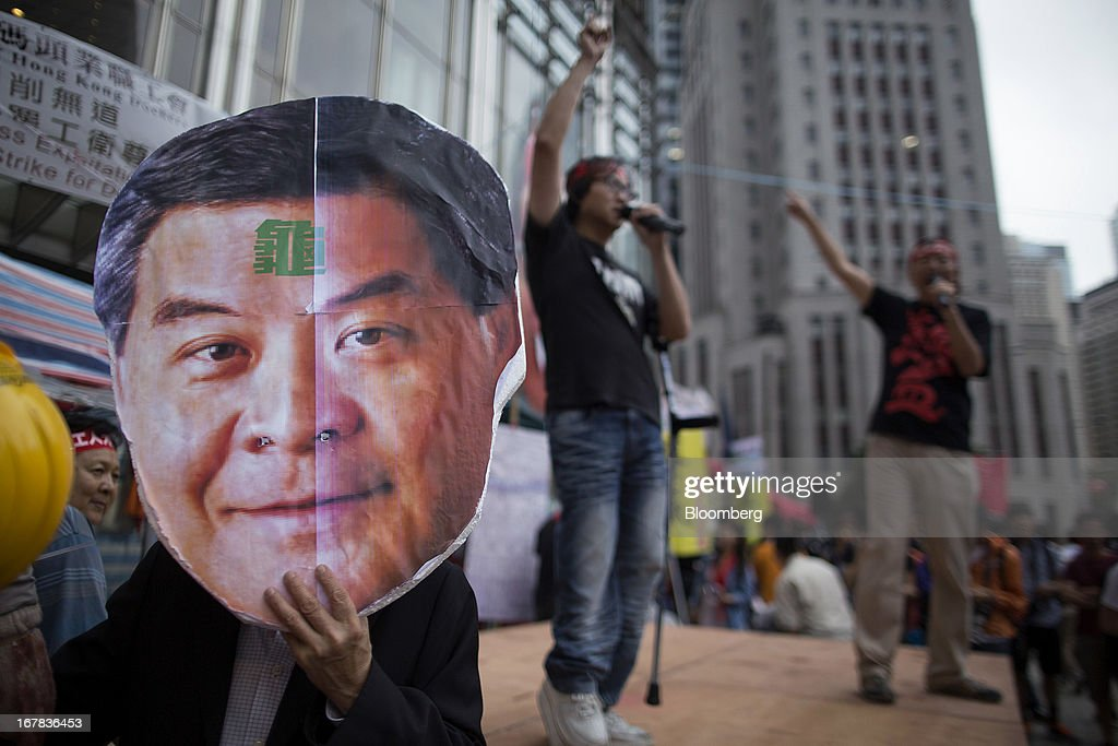A protestor displays an effigy of Leung Chun-ying, Hong Kong's chief executive, outside the Cheung Kong Center during a Labor Day march in Hong Kong, China, on Wednesday, May 1, 2013. Thousands of Hong Kong residents took to the streets today for Labor Day marches to petition for better labor conditions and in support of strike action by workers at docks operated by Li. Photographer: Jerome Favre/Bloomberg via Getty Images