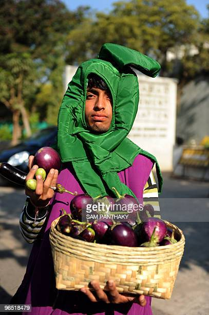 A protestor dressed as a brinjal waits for the arrival of Indian Union Minister for Environment and Forests Jairam Ramesh at the genetically modified...