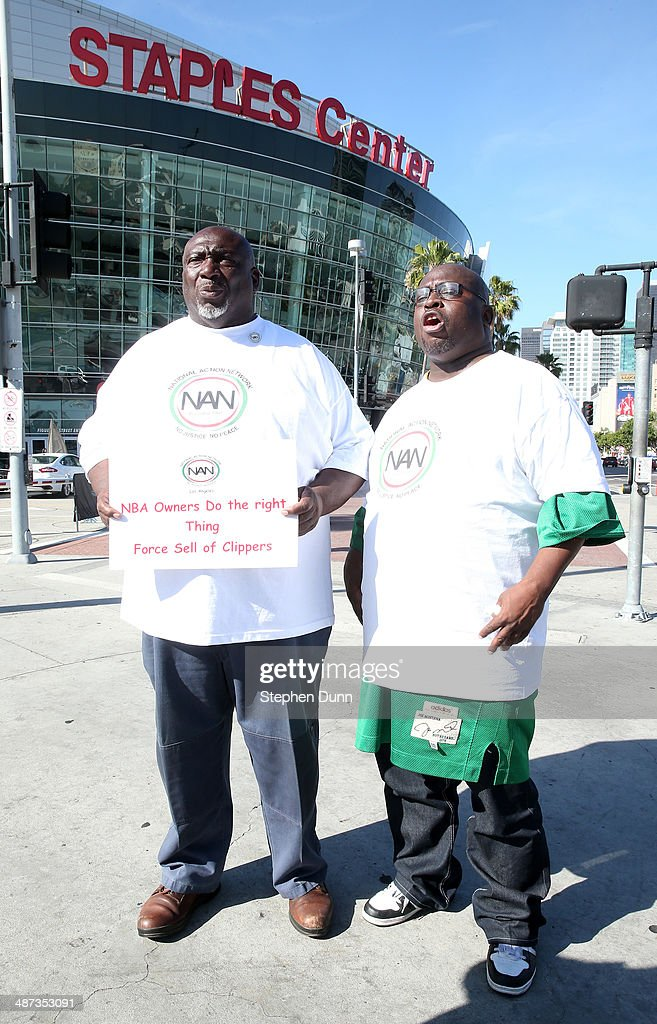 Protestor Elder Cummmngs of Los Angeles (L) and another who identified himself as 'Supreme' speak in the wake of Los Angeles Clippers owner Donald Sterling's remarks before Game Five of the Western Conference Quarterfinals during the 2014 NBA Playoffs at Staples Center on April 29, 2014 in Los Angeles, California.