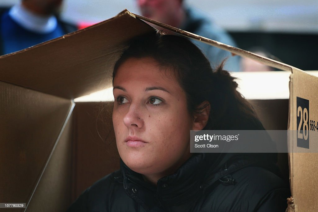 Protestor Elizabeth Scrafford sits in a shanty constructed of cardboard in the Federal Building Plaza on December 6, 2012 in Chicago, Illinois. Protestors built the shantytown, which they dubbed 'Durbinville' after U.S. Senator Dick Durbin (D-IL), to persuade Durbin to push for an increase of taxes on the wealthy and oppose cuts in Social Security, Medicare, and Medicaid