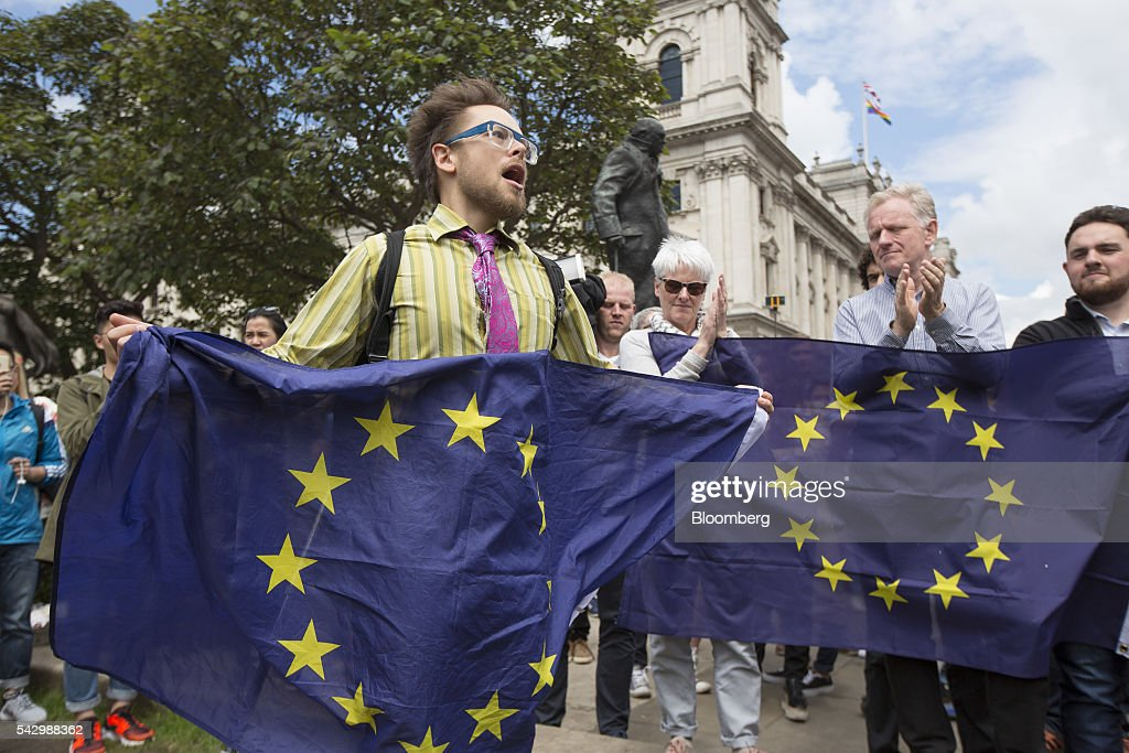 A protestor holding a European Union (EU) flag, addresses a crowd as he demonstrates against the European Union (EU) referendum result, in London, U.K., on Saturday, June 25, 2016. The U.K. voted to quit the European Union after more than four decades in a stunning rejection of the continent's postwar political and economic order. Photographer: Jason Alden/Bloomberg via Getty Images