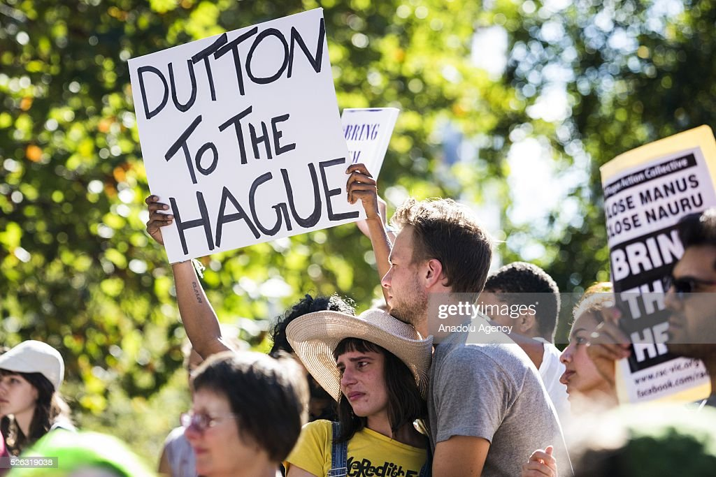 A protestor holds a banner during a protest demanding that asylum seekers held in off shore detention to be brought to Australia at a rally in Melbourne, Australia on April 30, 2016. Protests have started after The Papua New Guinean Supreme Court ruled that the Australian-run detention centres on Manus Island were illegal and unconstitutional.