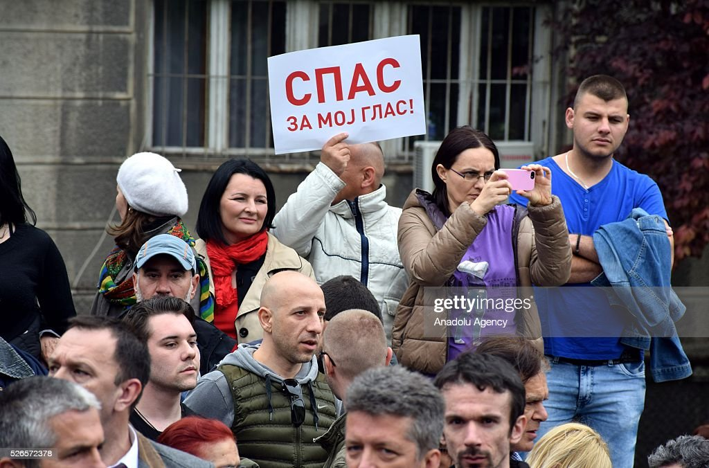 A protestor holds a banner in front of the Electoral Commission during a protest organised by Serbian main opposition parties against alleged electoral 'fraud' at last weekend polls in downtown Belgrade, Serbia on April 30, 2016.