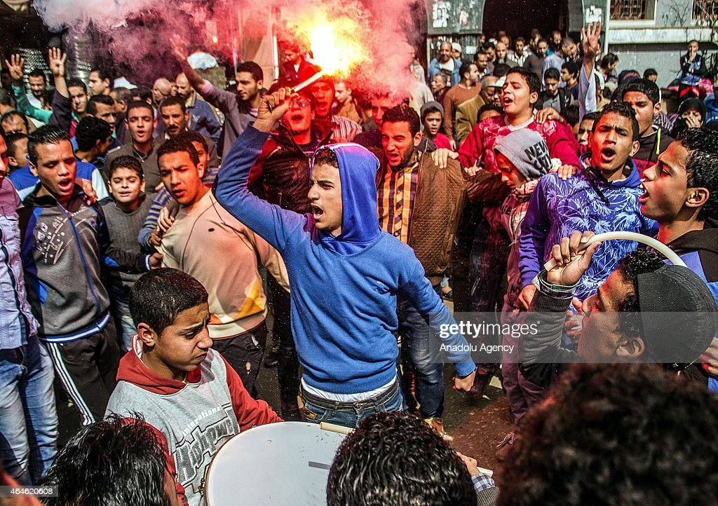A protestor holds a flare as Egyptians who call themselves as 'Anti-Coup demonstrators' stage a demonstration in the Al-Matariyyah district of Cairo, Egypt on February 27, 2015.