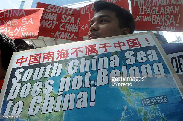 A protestor holds a placard at a rally in front of the Chinese Consulate in Manila's financial district on July 7 denouncing China's claim to most of...