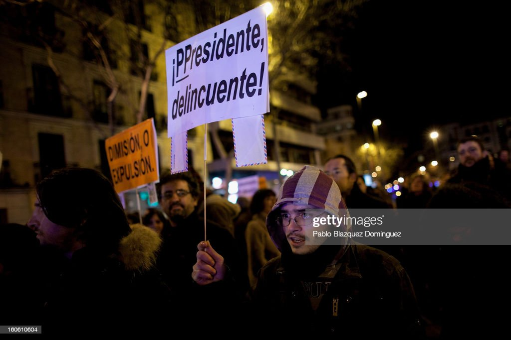 A protestor holds a placard during a demonstration against alleged corruption scandals implicating the PP (Popular Party) in the streets of Madrid on February 3, 2013 in Madrid, Spain. Spain's Prime Minister Mariano Rajoy denied yesterday receiving undeclared payments from his political party. More information on secret payments was revealed today and leader of opposition socialist Party (PSOE) urged Rajoy to resign.