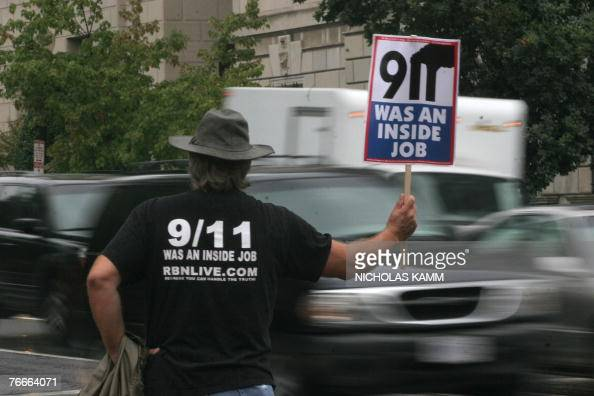 A protestor holds a sign claiming the 11 September 2001 attacks on the US were an inside job near the White House in Washington 11 September 2007 The...