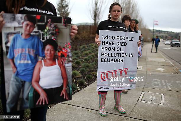 A protestor holds a sign during a demonstration outside of the Chevron headquarters on February 15 2011 in San Ramon California Donzens of...