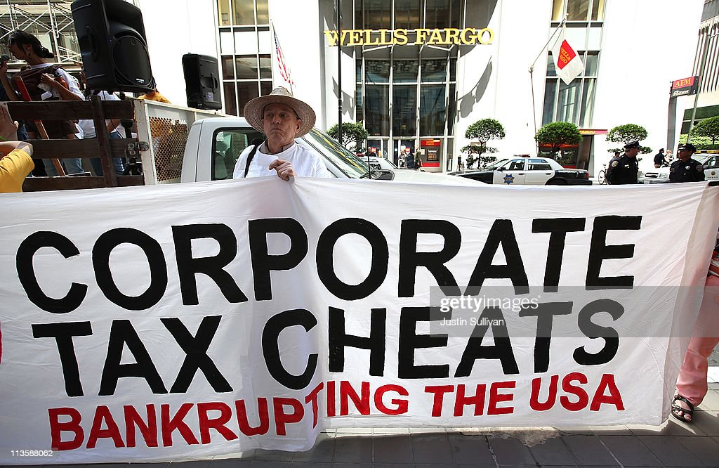 A protestor holds a sign during a demonstration outside of the Wells Fargo shareholders meeting on May 3, 2011 in San Francisco, California. Over 100 housing activists staged a demonstration outside of the Wells Fargo shareholders meeting accusing the banking giant of predatory lending, not paying taxes and foreclosing on homes by using fradulent paperwork.
