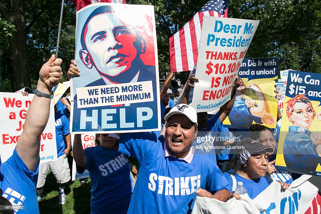 A protestor holds a sign in Upper Senate Park during a rally on Capitol Hill in Washington Wednesday July 22 to push for a raise to the minimum wage...