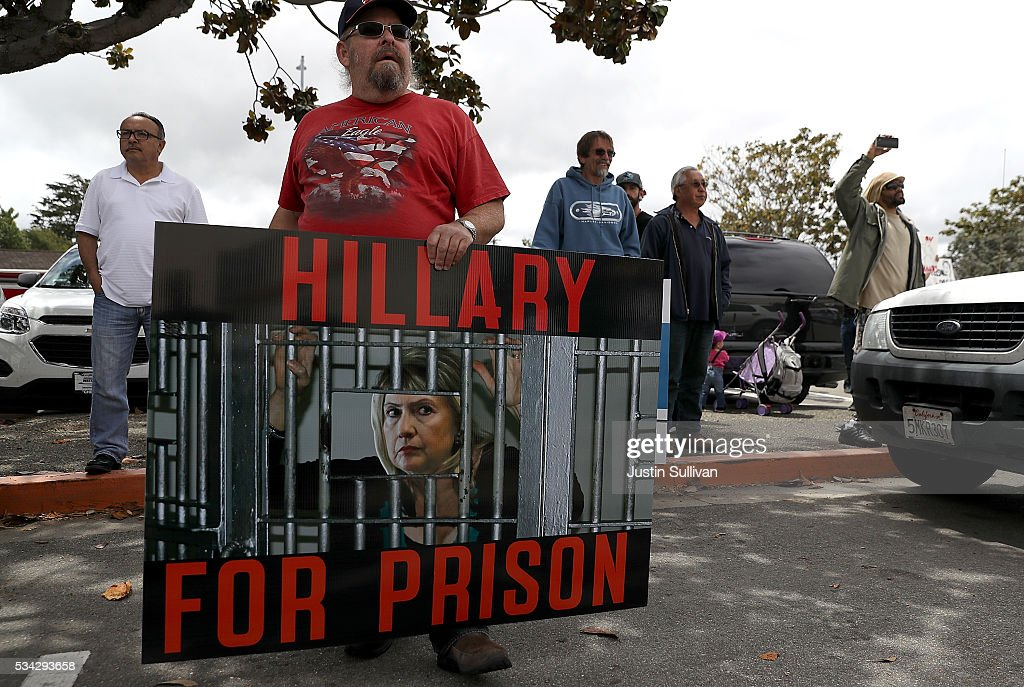 A protestor holds a sign outside of a campaign rally for democratic presidential candidate former Secretary of State Hillary Clinton at Harrell College on May 25, 2016 in Riverside, California. Hillary Clinton is campaigning in California ahaed of the State's presidential primary on June 7th.