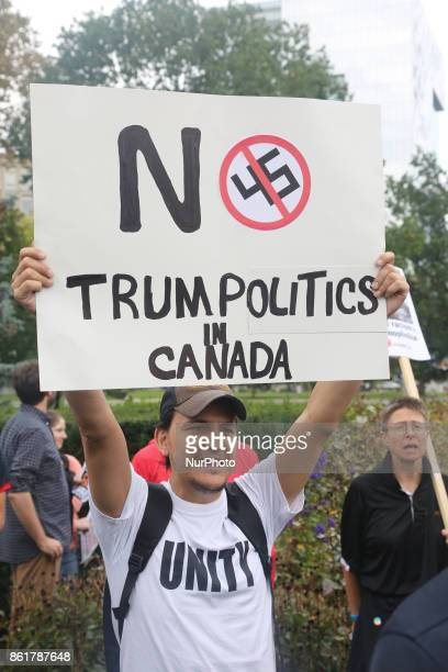 Protestor holds a sign saying 'No Trump Politics in Canada' during a rally against White Supremacy and Islamophobia at Queen's Park in Toronto...