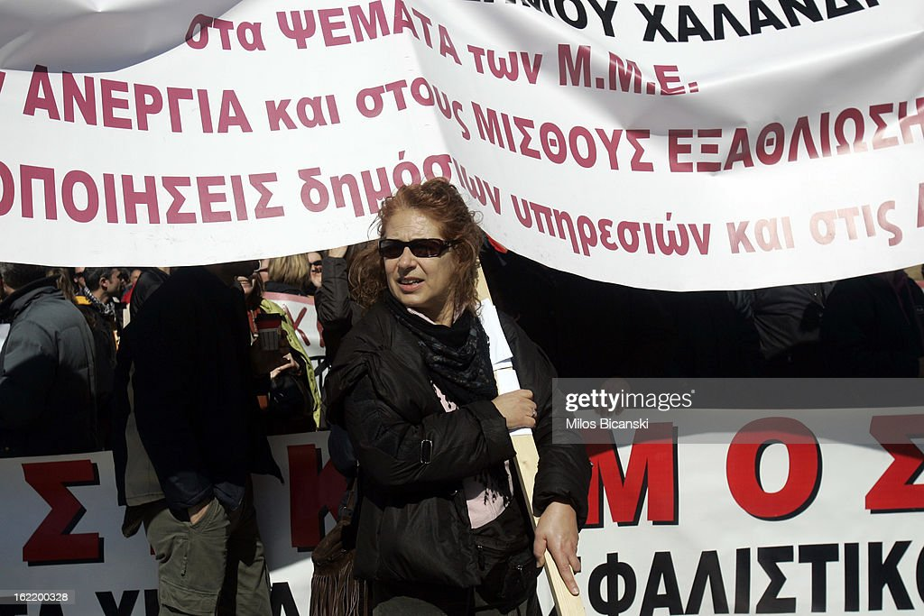 Protestor holds abanner outside Greece's parliament during a protest on February 20, 2013 in Athens, Greece. Unions have launched general strike against austerity measures in Greece, amid predictions unemployment in the crisis-hit country will reach 30 percent this year.